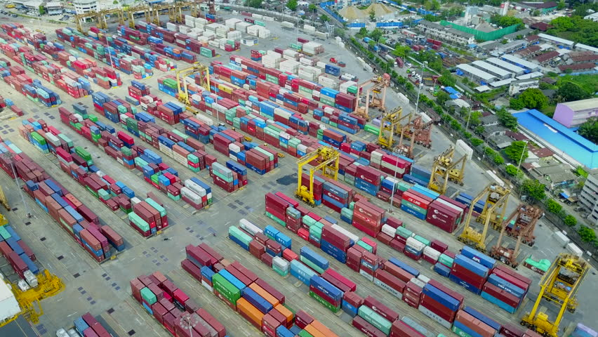 BANGKOK, THAILAND - NOVEMBER 11, 2018 : Logistics and transportation of container cargo freight ship with container crane in shipyard. Logistic import export business. Transport industry. Aerial view | Shutterstock HD Video #1019763034