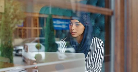 Female muslim hr manager at job interview, talking to a candidate and smiling, - modern muslim, human resources concept 4k