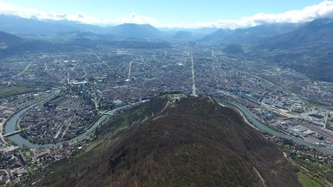 Grenoble city panorama view aerial drone shot sunny day French alps