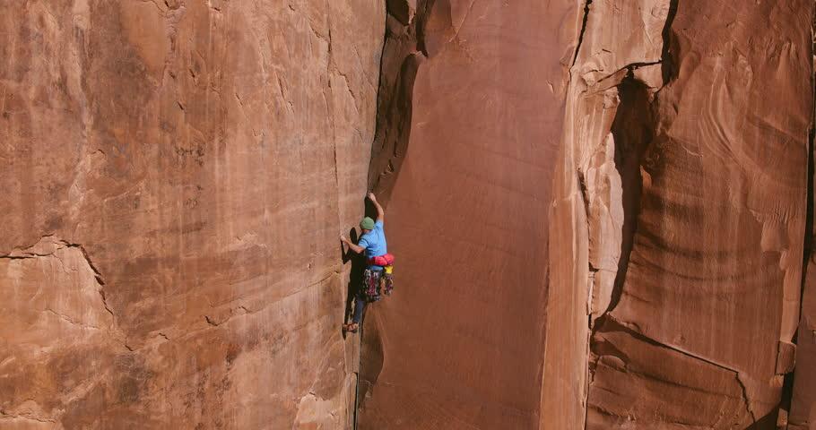 Man rock climbing extreme vertical rock climb   Shutterstock HD Video #1020027244