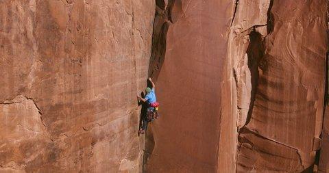 Man rock climbing extreme vertical rock climb