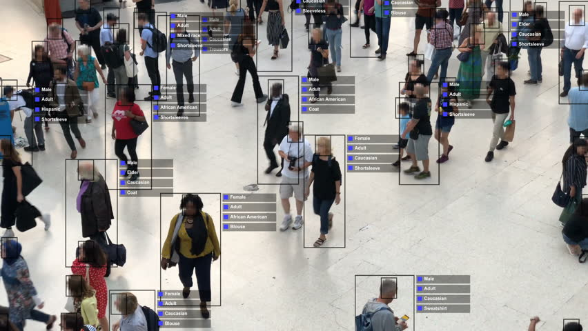Crowded building with commuters walking. Artificial intelligence and facial recognition are used for surveillance purposes. Individual data showing sex, race and clothing. Deep learning. Futuristic. | Shutterstock HD Video #1020030844