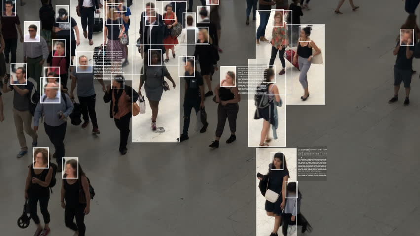 High view of commuters walking. Facial recognition interface showing personal data for each person. Surveillance concept. Artificial intelligence. Deep learning. | Shutterstock HD Video #1020030874