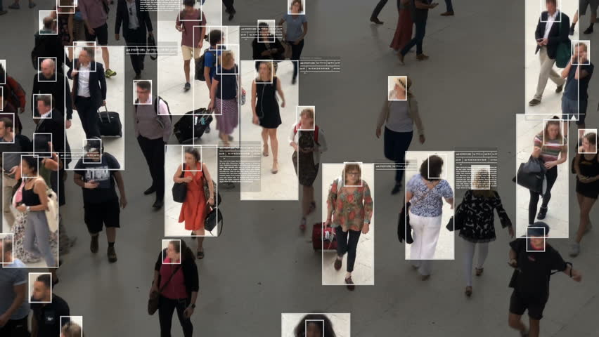 High view of commuters walking. Facial recognition interface showing personal data for each person. Surveillance concept. Artificial intelligence. Deep learning. #1020030874