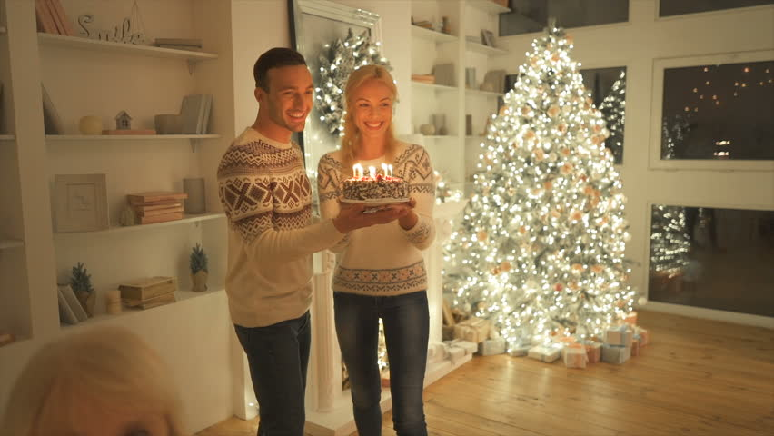 The couple giving a birthday cake with candles to old man. slow motion | Shutterstock HD Video #1020031624