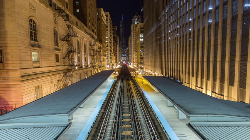 Night timelapse of Chicago loop aerial subway loop station metro train track