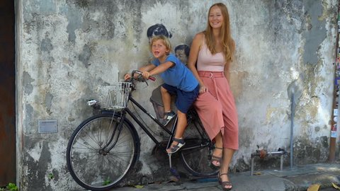 Mother and son on a bicycle. Public street art in Georgetown, Penang, Malaysia