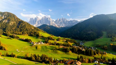 Time lapse of Santa Maddalena village with majestic Dolomite mountains in background, Val di Funes valley, Trentino Alto Adige region, Italy, Europe. Sunset in a  Italian Dolomites.