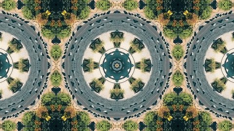 Kaleidoscope effect of aerial top-down view of roundabout road traffic