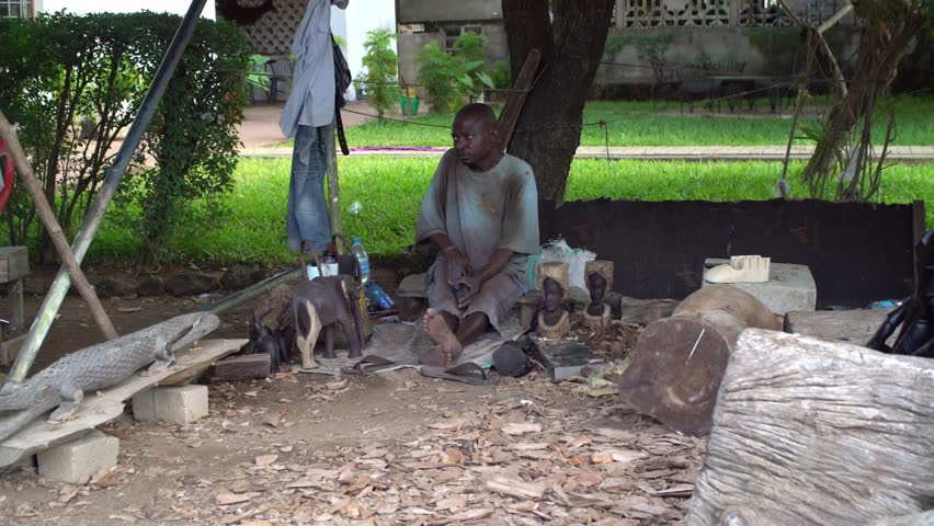 Dar es Salaam, Tanzania, circa January 2018: African craftsman working with wood   Shutterstock HD Video #1020280234