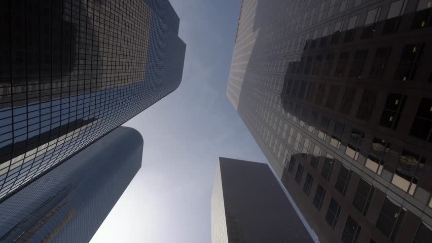Dolly gliding looking up view of modern skyscrapers in Los Angeles city financial district