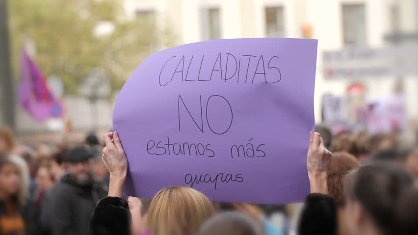 Poster with inscription in spanish. Shut up we are not prettier. Feminist Activists in a Demonstration. March for the International Day of Nonviolence against Women and Children in Barcelona, Spain | Shutterstock HD Video #1020339994