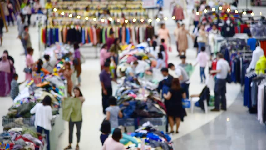 booth sale and people buying. defocus. footage #1020351544