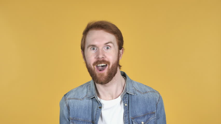 Crazy Redhead Man Doing Funny Movements Isolated on Yellow Background | Shutterstock HD Video #1020381394