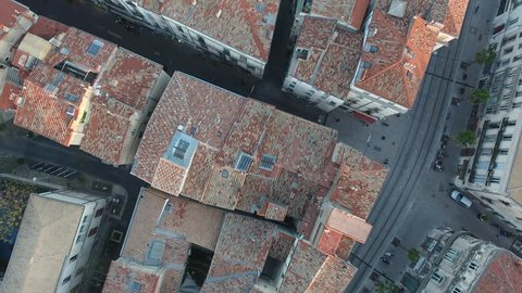 Overhead drone view of Montpellier roofs old mediterranean city. Aerial vertical