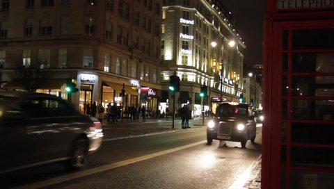 Strand, London UK -  Feb 13th 2019: bus taxi phone box on the Strand road night London England . Tourism  landmark vacation holiday London red London bus black taxi cab stock, footage, video, clip