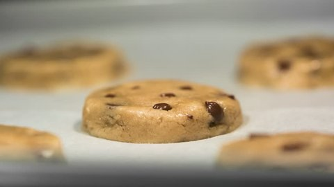 Chocolate chip cookies baking in oven time lapse macro /  close up.