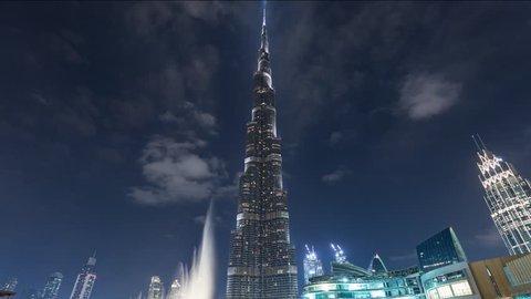Dubai, United Arab Emirates - November 11, 2018: Timelapse hyperlapse of Burj Khalifa skyscraper tower. The tallest building in the world. Filmed at night with fountain in front. UAE