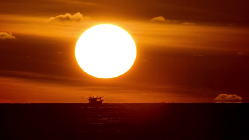 Sunset is a fishing boat running under the sun. | Shutterstock HD Video #1020547924