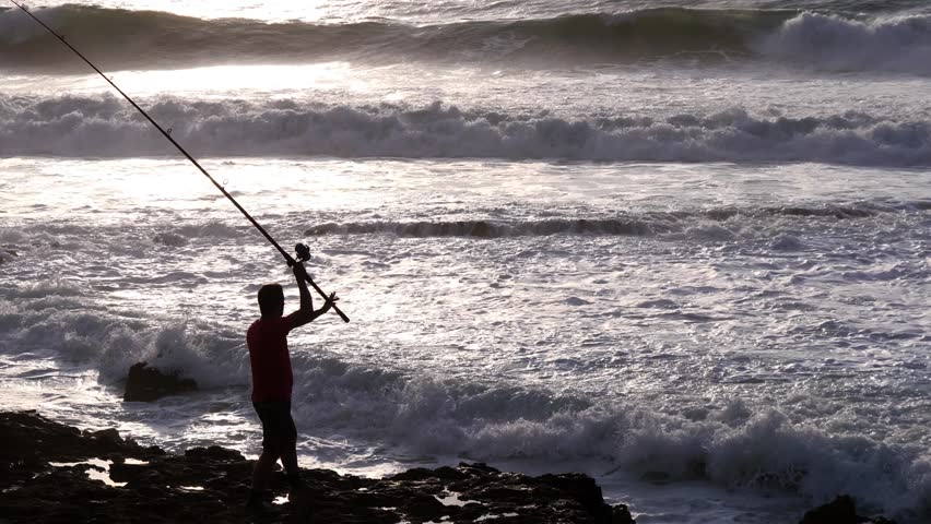 Fisherman fishing rod and reel 4k | Shutterstock HD Video #1020625024