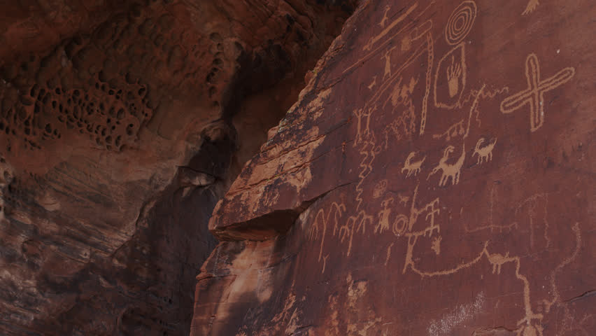 Prehistoric Fremont Culture Native American Rock Art / Petroglyphs at Atlatl Rock in the Valley of Fire State Park in Nevada | Shutterstock HD Video #1020643384