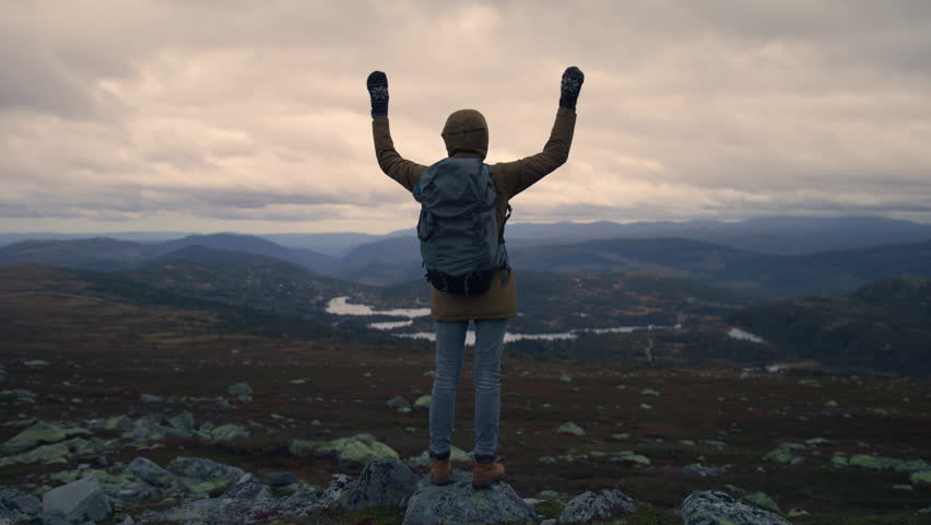 Epic view from top of the mountain in Norway and hiker giving respect to nature | Shutterstock HD Video #1020651664