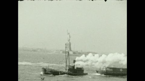 1920s: New York City skyline from busy harbor. Small motorboat speeds across harbor. Tugboat steams across harbor.