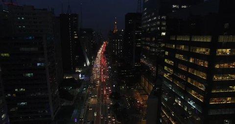 São Paulo, São Paulo / Brazil - 11/21/2018: Aerial view of Paulista Avenue at night with its commercial buildings illuminated