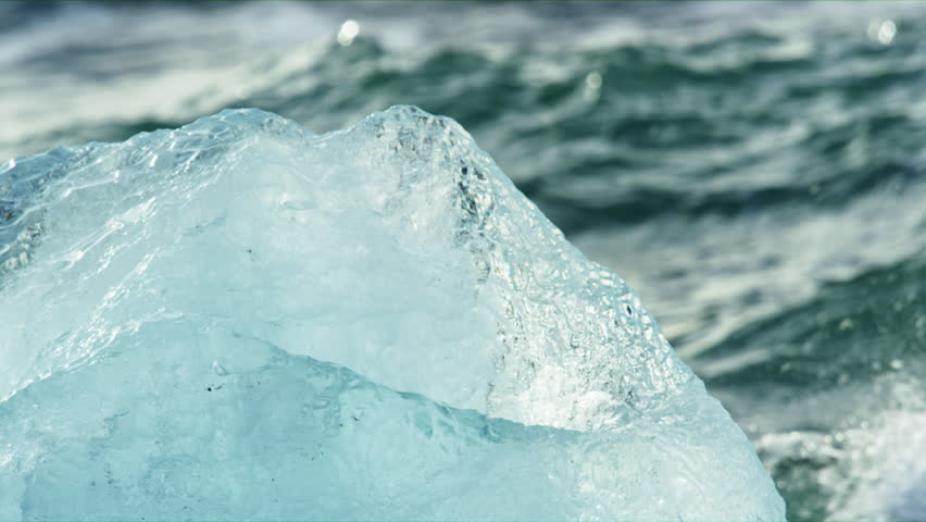 A video of an iceberge as the waves crash through it on Diamond Beach | Shutterstock HD Video #1020740014