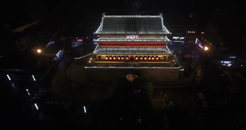 bell tower in xian at night shooted by drone
