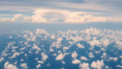 Travelling by air above clouds. View from airplane window. Journey from Johor Bahru to Kuala Lumpur, Malaysia