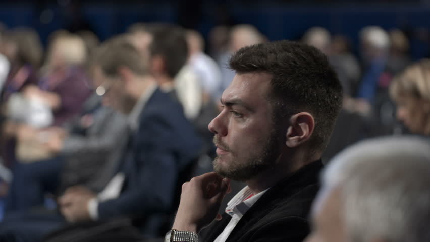 Crowded politics convention work in marketing center. Caucasian attractive listener or expert on row of seats at company briefing for success information cooperation. View speaker speech in large room | Shutterstock HD Video #1020788584