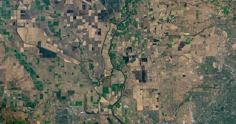 Very high-altitude overflight aerial of farmland northwest of Sacramento California. Clip loops and is reversible. Elements of this image furnished by NASA