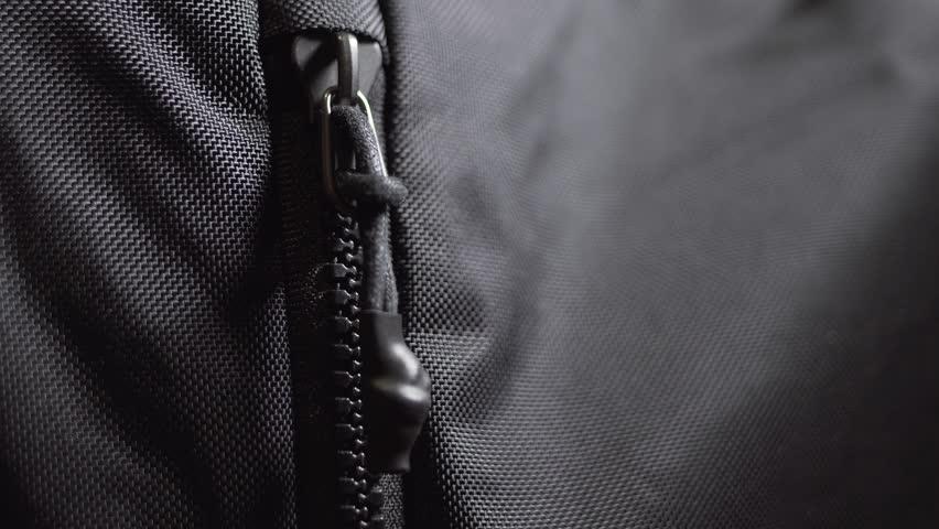 Man unzips and zips black nylon sport backpack bag. Close up shot, 4k. | Shutterstock HD Video #1020902074