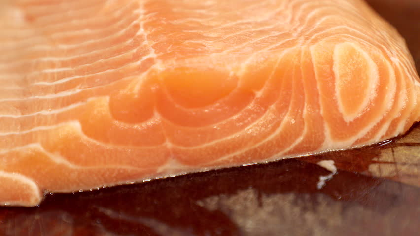 Sushi Chef Slices a Salmon Steak Nigiri. A sushi-man preparing sushi nigiri fish. #1020923944