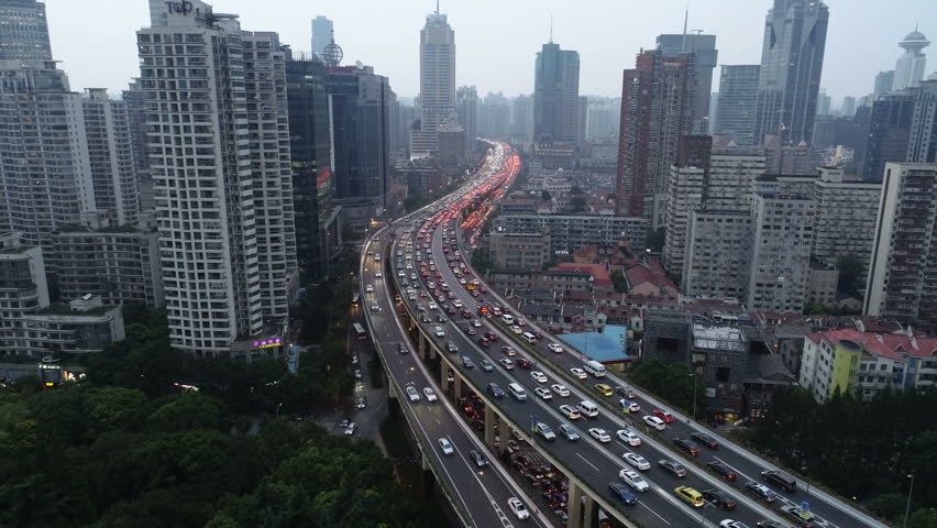 Drone flight over traffic jam on major elevated highway at dusk in Shanghai, urban development and transportation in China | Shutterstock HD Video #1020945004