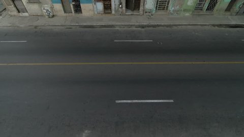 high angle aerial establishing shot of classic car on Malecon street of Havana, Cuba
