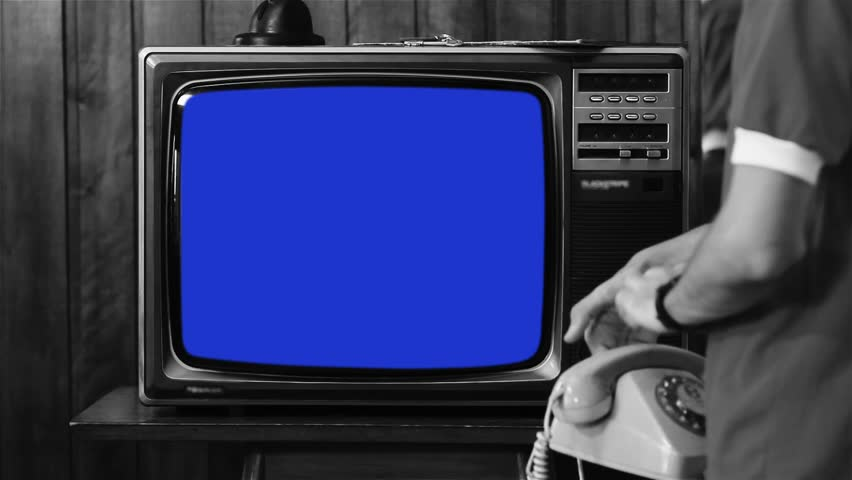 "Kid Talking on Vintage Phone and Watching Old 1980s Tv with Blue Screen. Ready to Replace Blue Screen with Any Footage or Picture you Want. You Can Do it With ""Keying"" (Chroma Key) Effect. BW Tone. #1020975064"