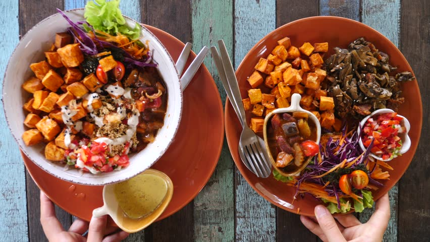 Healthy Vegan Bowls With Baked Batata Potato, Fried Mushrooms And Fresh Vegetables.