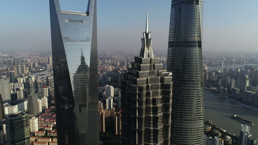 SHANGHAI, CHINA - SEPTEMBER 2018: Close drone shot of spectacular skyscrapers in the central business district of Pudong, high-rise office towers in Shanghai city, urban development in modern China | Shutterstock HD Video #1021110364