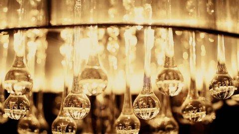 luminous glass lamps in a luxury chandelier. crystal light.