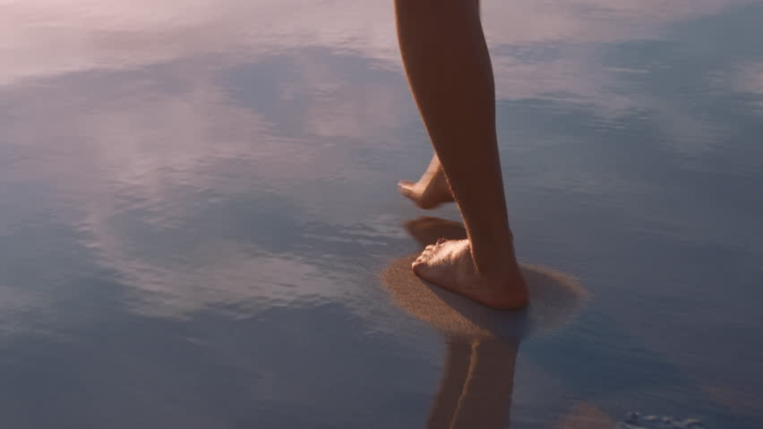 Close up woman feet walking barefoot on beach at sunset leaving footprints in sand female tourist on summer vacation | Shutterstock HD Video #1021159714