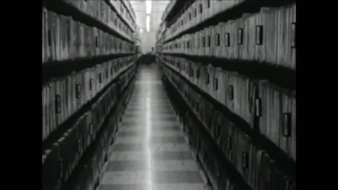 CIRCA 1940s - In Washington DC, case histories and files from other investigative agencies are kept in the file vaults of the OSI.