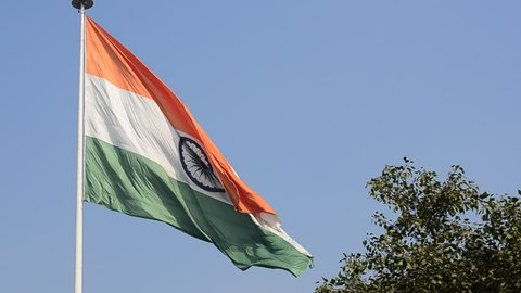 Indian National Flag, the tricolor fluttering and unfurling in the Central Park at Connaught Place. It is the largest Indian flag on public display in Delhi, India