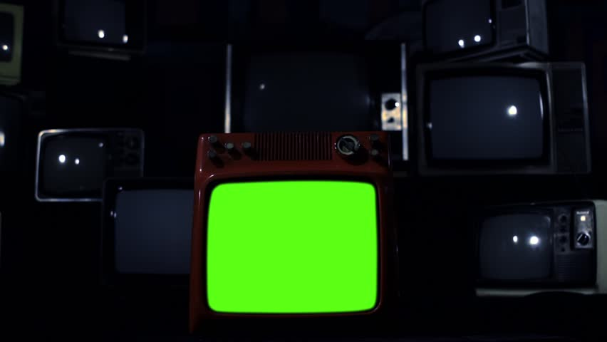 "Vintage Tv Turning On Green Screen. Dark Tone. Zoom In. Ready to replace green screen with any footage or picture you want. You can do it with ""Keying"" (Chroma Key) effect. 