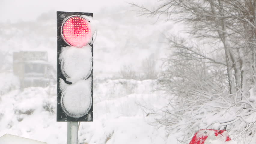 Traffic light in the snow. Traffic light covered with snow