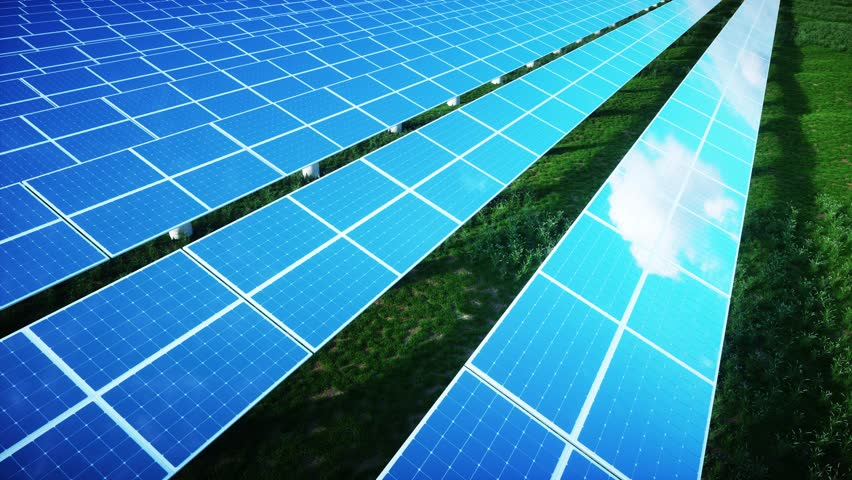 Beautiful reflection of clouds on blue solar cells of a large solar farm in a warm late afternoon light with fresh green grass under the panels. 3d rendering.