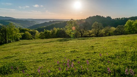 Sunset in the Massif Central mountains in France, Lot and Occitanie region, timelapse in the summer.