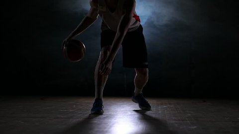Sportsman playing basketball in basketball court