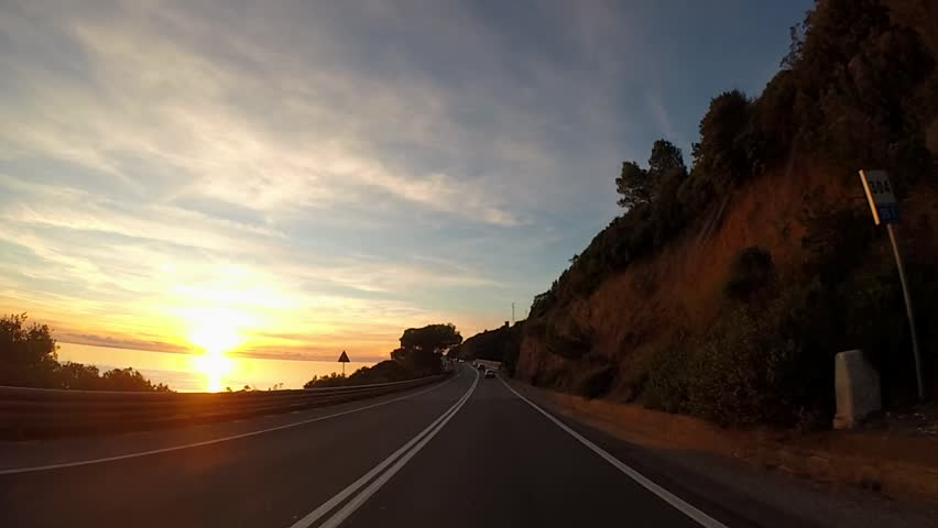 Driving in scenic highway at sunset, Tuscany, Italy    Shutterstock HD Video #1021511134